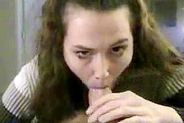 Swallowing brunnete washes down cum with coke...
