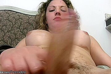Striking shemale with curly hair strokes her thick...