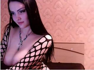 Brunette diva with huge juggs spreading legs on web camera